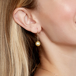 Golden Pearl Dangling Tincup Earrings - Model Image